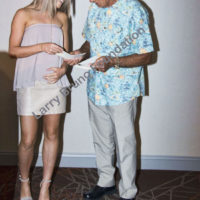 Joe N gives award to Madison Amelia of BH High